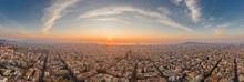 Barcelona, Spain - Feb 25, 2020: Aerial Panorama Shot Of Barcelona Coastline Sun Rising Over Horizon In Winter Morning