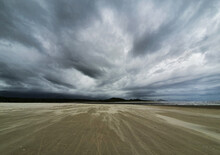 Storm Clouds Over The Sand