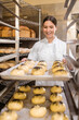 Involved woman folding baking trays with buns
