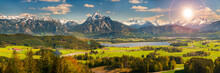 Beautiful Rural Landscape In Bavaria With Mountain Range And Meadow At Springtime