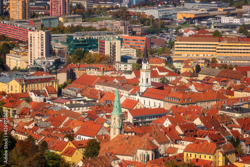 Canvas-taulu Aerial view of the historic center of Celje city with belfries and red tiled roofs, scenic cityscape, Slovenia, Styria
