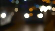 Unfocused Shot Of Heavy Traffic Late SAt Night On A Big Avenue