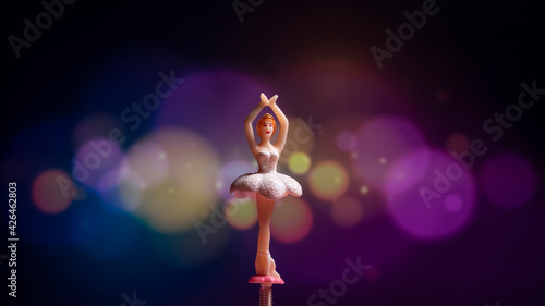 Fotografie, Obraz A ballerina figurine with colorful modern bokeh background.