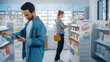 Leinwandbild Motiv Big Moder Pharmacy Drugstore: Diverse Group of Multi-Ethnic Customers Browsing, Searching, Comparing Medicine Packages, Drugs Boxes, Pill Vitamins, Supplements, Purchasing Health Care Products.