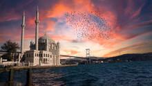 Ortakoy Mosque (Ortakoy Camii) And Bosphorus Bridge (Bogaz Koprusu), Istanbul. Beautiful Landscape Of Old Buyuk Mecidiye Mosque With Sunset Or Sunrise Background. Islamic House Of Worship For Muslims.