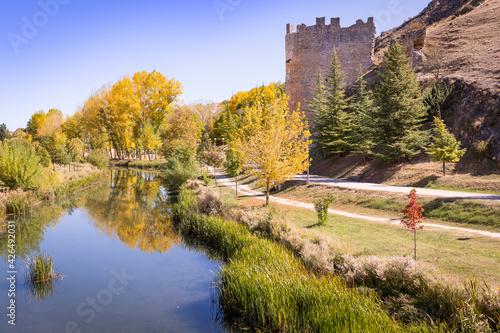 the Ucero river and a defensive tower next to El Burgo de Osma-City of Osma, province of Soria, Castile and Leon, Spain