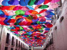 Low Angle Of Multicolored Umbrellas Covering The Stree