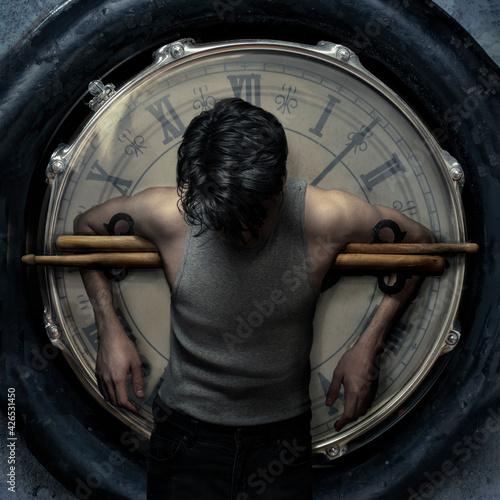 Valokuvatapetti drummer hanging on a clock with drum sticks