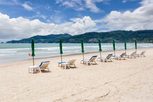 Beach Umbrella Made Of Palm Leafs On A Perfect White Beach In Front Of Sea In At Patong Beach