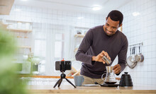 Startup Successful Small Business Owner Sme Handsome African Black Man Video Online Marketing With Camera In Cafe. Portrait Young Man Barista Cafe Owner. SME Entrepreneur Blogger Business Concept
