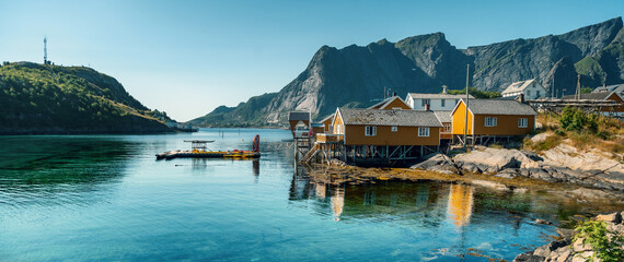 View of the city of Rhine on the Lofoten islands, a beautiful bright landscape, yellow houses on the beach