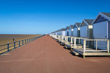 A Row Of Beach Huts Lined Along The Promenade At The English Seaside In Blackpool
