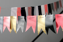 Decorations From Flags For The Holiday. Color Gold, Pink Blak.