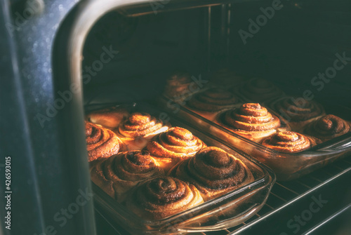 Fotografiet The fresh and tasty bakery is cooking in the oven
