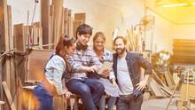 Handyman Team On Social Media Using Tablet Computer