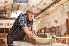 Craftsmen As Carpenter Master Planing Wood