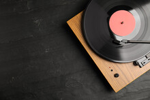 Turntable With Vinyl Record On Black Background, Top View. Space For Text
