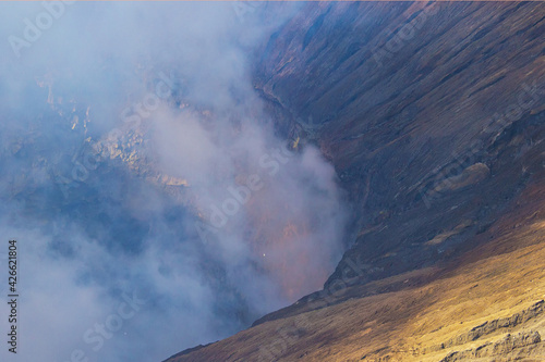 Photo Crater with active volcano smoke and sulfur, view from the observation deck of erupting and active Bromo volcano