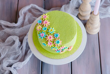 Beautiful Round Velvet Light Green Sponge Cake, Decorated With Colorful Flowers Made Of Chocolate And Mastic. Top View.