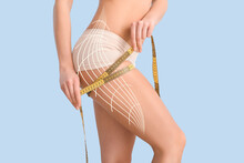 Young Woman With Measuring Tape On Color Background. Concept Of Cellulite