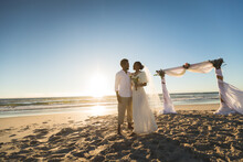 Happy African American Couple In Love Getting Married, Embracing On Beach During Sunset