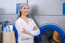 Woman Standing Near Large Washing Machine