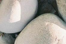 Close Up Of Curved Rocks On Beach