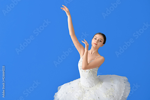 Fotografie, Obraz Beautiful young ballerina on color background