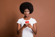 Portrait Of Impressed Displeased Dark Skin Person Open Mouth Staring Phone Isolated On Brown Color Background