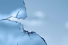 Broken Window Glass On A Background Of Blue Sky