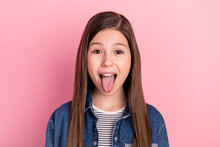 Photo Portrait Of Wearing Jeans Jacket Little Girl Grimacing Showing Tongue Isolated On Pastel Pink Color Background