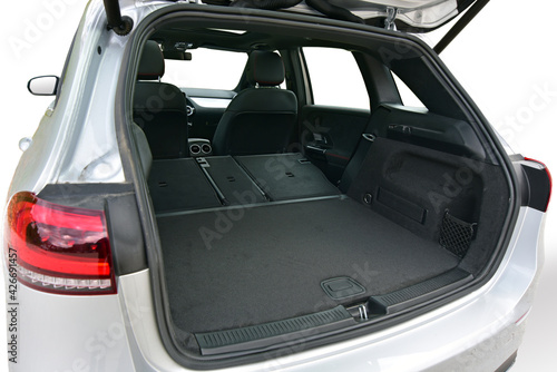 Fototapeta Empty trunk with rear seats folded of the passenger car