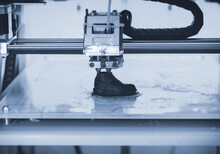 3D Printer Prints The Form Of Molten Plastic Blue Close-up.