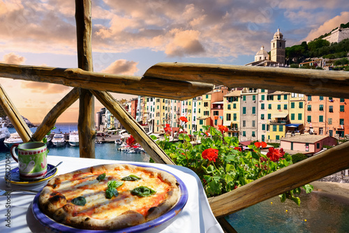 Fotografia, Obraz Pizza place terrace overlooking to beautiful Porto Venere harbor, Italian Riviera, Liguria
