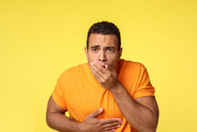 Masculine Man Want Vomit, Feeling Sick And Unwell, Ate Too Much Junk Unhealthy Food, Touching Stomach And Cover Mouth With Palm As Standing Yellow Background Sick, Puke From Disgust