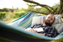 Serene Man With Digital Tablet Sleeping In Backyard Summer Hammock
