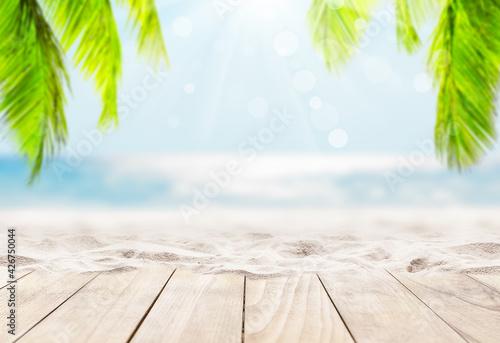 Billede på lærred Wooden table top on blue sea and white sand beach background.