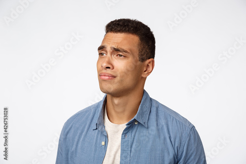 Fototapeta Man feeling regret, missing something interesting, dont have money, cant afford something