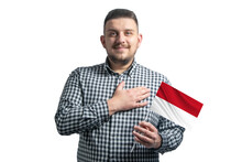 White Guy Holding A Flag Of Indonesia And Holds His Hand On His Heart Isolated On A White Background With Love To Indonesia