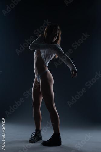 Fotografija Naked beautiful woman posing on black background. Fine Art style.
