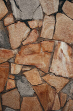 A Wall Of Stone. The Texture And Pattern Of The Stones. Natural And Eco-friendly Material For Construction.