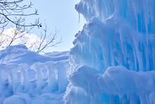 Ice Castle Covered In Snow And Melting Slowly In The Winter Sun