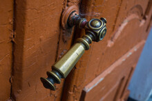 Old Door With A Brass Handle