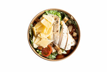 Caesar Salad With Chicken Fillet In A Take-away Box Isolated On White Background. Delicious Fresh Chicken Salad In A Round Broun Food Container.