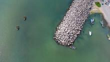 Boats Making Walks Along The Sea Coast