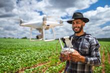 Smart Farming Concept, Latin American Farmer Using Drone In Field