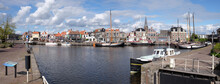 Widescreen Photo With Cityscape Of Lemmer Harbor In Friesland, The Netherlands With Pleasure Yachts And Sailing Boats And Lock Gate On The Right