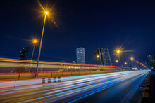 Long Exposure Shutter Speed Of Car Moving In Road