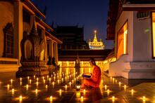 Night Urban City Skyline Of Landmark Bangkok. Wat Saket. Night Scene Of Phu Khao Thong (Golden Mountain) And Monk Reading A Book.