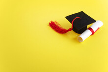 Academic Hat With Diploma On Yellow Background. Graduation Theme